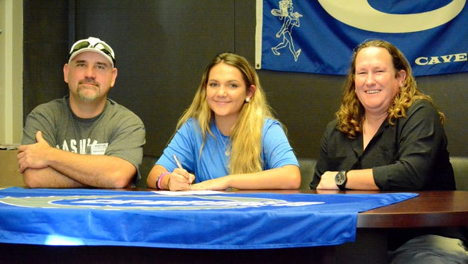 Carlsbad's Madison Austin signs her letter Thursday to play soccer at NAIA's University of the Southwest in Hobbs.