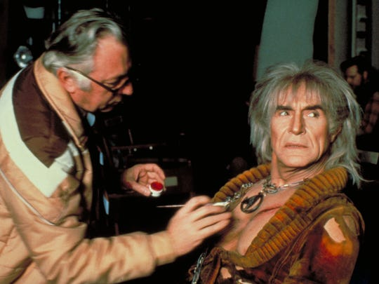 Before any conspiracy theories start, this is just touching up Ricardo Montalban's chest before shooting. Those pecs were real!