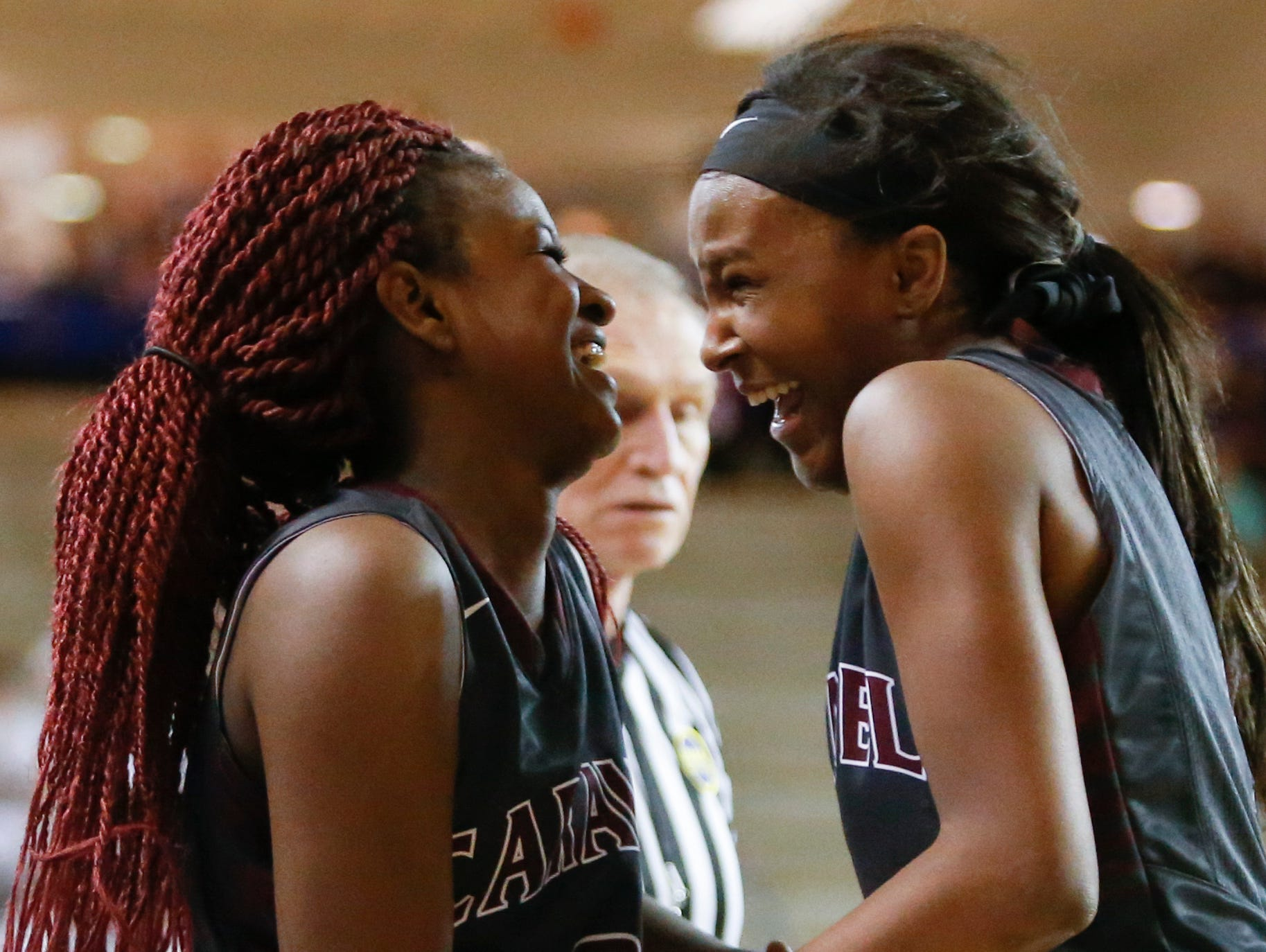Caravel's Maia Bryson (left) and Sasha Marvel have a laugh over Bryson's fall as she was fouled late in the second half of Caravel's win in a DIAA state tournament semifinal Wednesday at the Bob Carpenter Center.