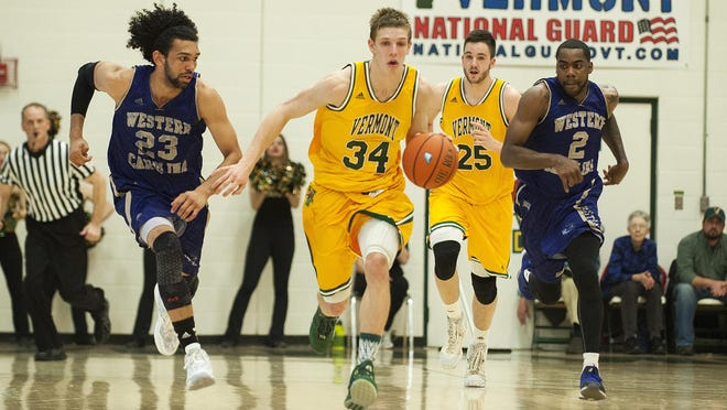 Catamounts guard Kurt Steidl (34) dribbles the ball down the court during the men's basketball game between Western Carolina and Vermont in the opening round of the College Basketball Invitational at Patrick Gym on Wednesday night.
