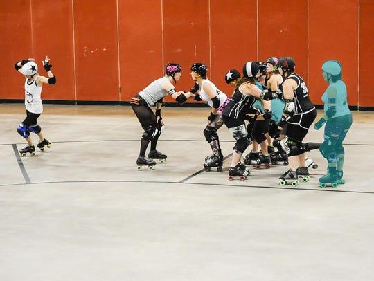 """Brittney """"Britt-knee Basher"""" Morris (far left,) calls"""