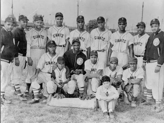 The Garfield Colored Giants 1949 team pictured from left to right: (front row) Junior Cooke, Michael Watson Jr., Gene Wright, Cleveland Buggs, Pettis Johnson, and the Nelson Brothers; (back row) John Foster (manager), James Watson, Pierce Watson, Albert Campbell, John Logan, Bill Thorton, Otis Robinson, Fred Elam, and Purvis Buggs.