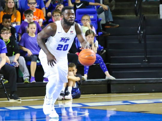 Giddy Potts reads the floor during the Blue Raiders' 102-64 win over Milligan College on Friday, Nov. 11, 2016.
