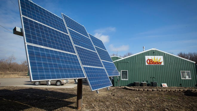 West Des Moines should embrace solar panels, like those shown in Des Moines, and pass laws that make it easy for residents to install the alternative energy source at their homes, a handful of residents said at a public hearing Monday.