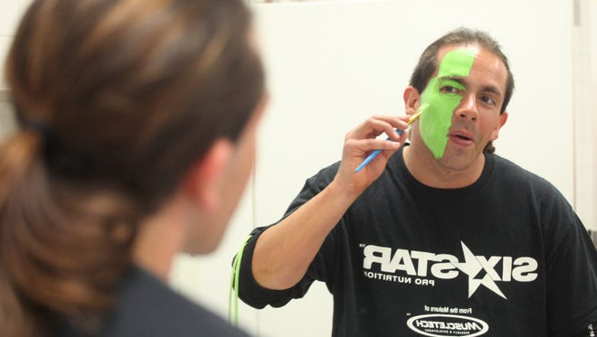 Stephen D'amico paints his face in the bathroom of the Riverside Center prior to a show organized by REAL Pro Wrestling.