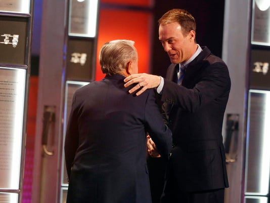 Kevin Harvick, right, embraces Rex White as White is inducted into the NASCAR Hall of Fame, Friday, Jan. 30, 2015, in Charlotte, N.C. (AP Photo/Nell Redmond)