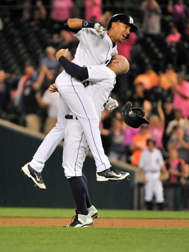Detroit Tigers'  Tyler Collins lifts up Dixon Machado