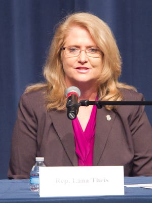 State Rep. Lana Theis talks about issues at a candidates forum held in Hartland Thursday night.