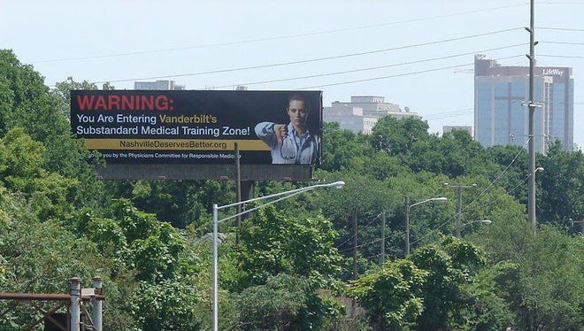 A billboard, which hovers over Interstate 40 near Charlotte Avenue