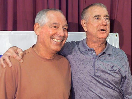 FSU baseball coach Mike Martin (right) puts his arm around long-time friend Texas coach Augie Garrido at the end of a press conference for the NCAA Super Regional in Tallahassee in 2003. Garrido died in March 2018.