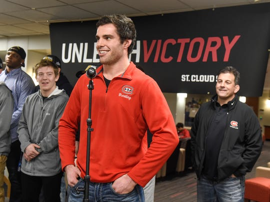 Wrestler Vince Dietz speaks during a celebration held Wednesday, March 14, to honor the St. Cloud State wrestling team for their third NCAA Division II championship in four years.
