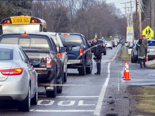 An official talks with a motorist outside Jackson Township