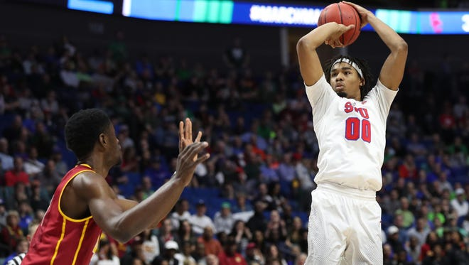 Mar 17, 2017; Tulsa, OK, USA; Southern Methodist Mustangs forward Ben Moore (0) shoots during the second half against the USC Trojans in the first round of the 2017 NCAA Tournament at BOK Center.