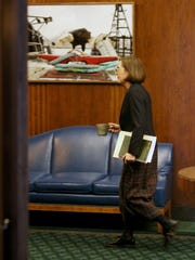 Oregon Gov. Kate Brown walking in the governor's office