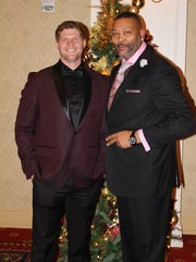 Centria Healthcare CEO Scott Barry and Curtis Moore, former Centria senior sales executive, are photographed together at a company holiday party.