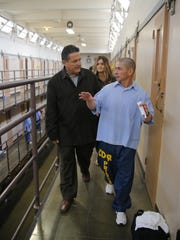 Placencia (right) leads a staff member from Palma High School through the Correctional Training Facility state prison in Soledad during a visit by the school's staff last year.