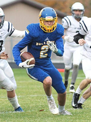 Tyler Swanwick of Centreville returns a punt for a touchdown against Mt. Morris to end the regular season.