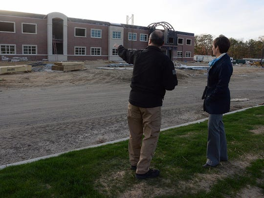 CCTEC assistant principal Patty Robbins (right) and law enforcement program instructor Andre Lopez are seen at the site of the school's new building on the campus of Cumberland County College on Tuesday.