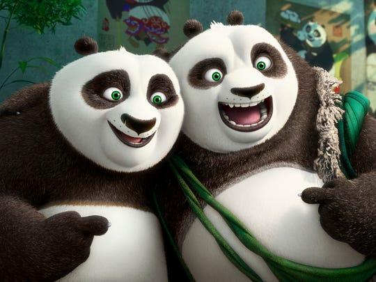 Po (left, voiced by Jack Black) and his long-lost panda