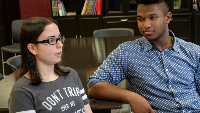 Westside seniors Gabriella Alicea, left, and Jonathan Bruce talk on Monday about how students are preparing to remember the 17 high school students who died at a school in Florida. Schools nationwide are aware of possible walkouts on Wednesday morning from 10 a.m. to 10:17 a.m. Students and faculty at Westside discussed the reasons for their walk, at the nearby track where they can safely make their statement.