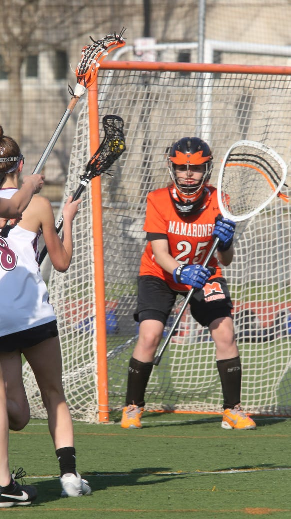 Mamaroneck's Talia Land (25) guards the net against