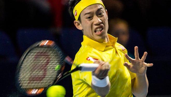 Japan's Kei Nishikori returns to Argentina's Juan Martin del Potro during their quarterfinal match at the Swiss Indoors.