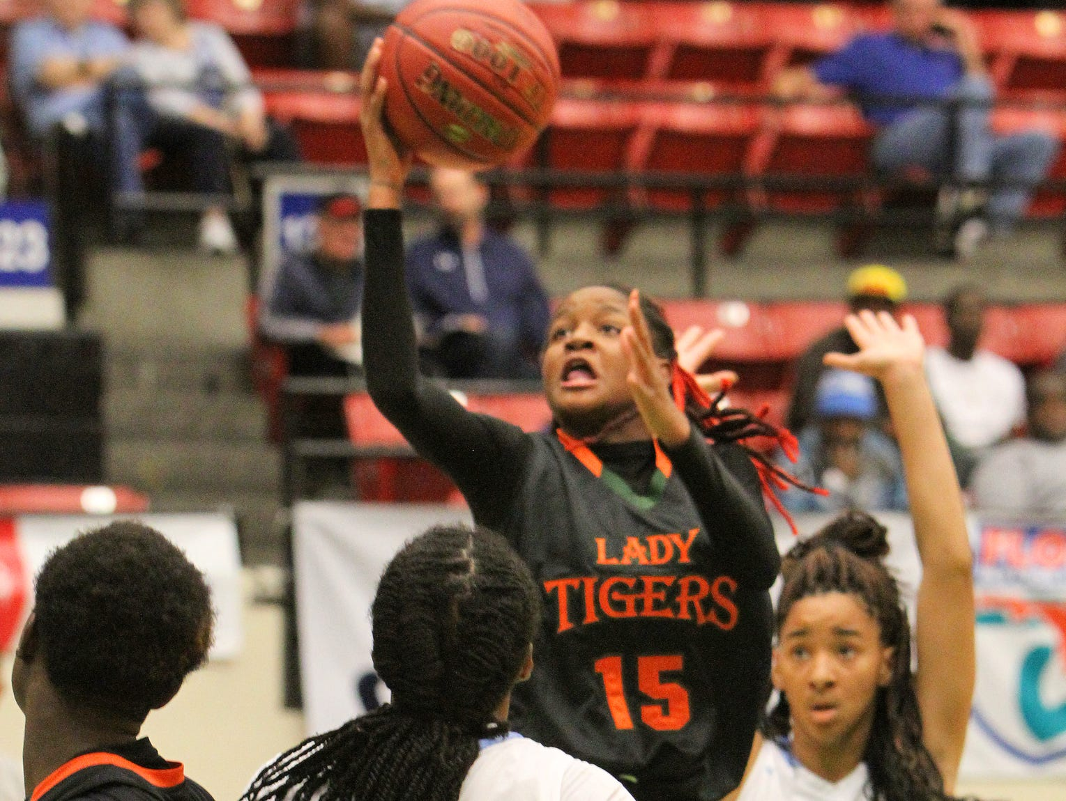 Dunbar's Dekeriva Patterson goes up for a basket as the Ribault defense closes in during the FHSAA Girls 5A Basketball semi finals Thursday February 18, 2016 in Lakeland, Florida. Dunbar lost the match 51-44.