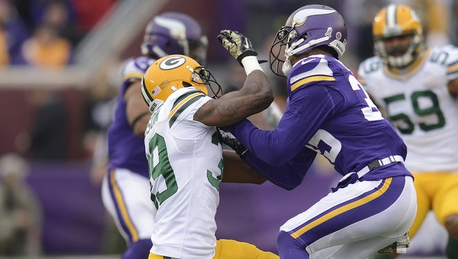Green Bay Packers' Demetri Goodson (39) collides with Minnesota Vikings' Marcus Sherels (35) on a punt return during Sunday's game at TCF Bank Stadium on the campus of the University of Minnesota in Minneapolis. Evan Siegle/Press-Gazette Media