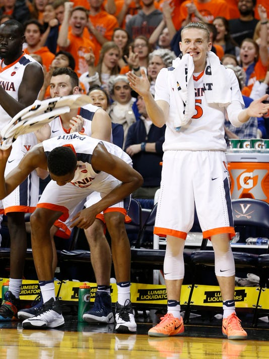 Virginia guard Kyle Guy,right, and teammate Virginia forward Mamadi Diakite, left, celebrate their win over Louisville during the second half of an NCAA college basketball game in Charlottesville, Va., Monday, Feb. 6, 2017. Virginia defeated Louisville 71-55. (AP Photo/Steve Helber)