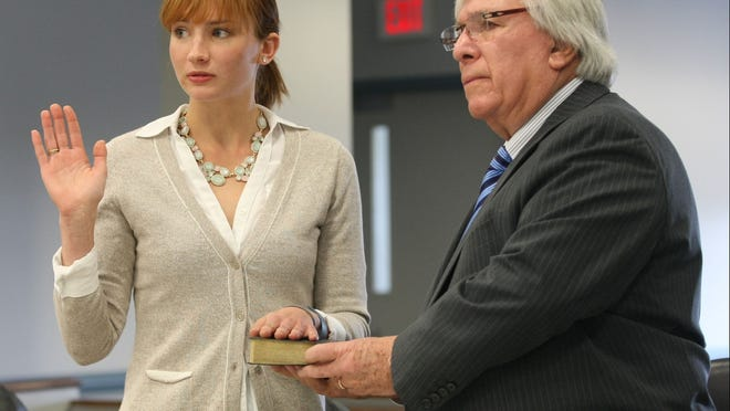 "Zoe Everett, left, swears in with her attorney, Stephen ""Skippy"" Weinstein, before giving testimony at her lawsuit settlement in State Superior Court, Morristown on March 13, 2015."
