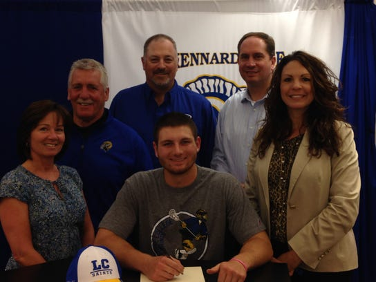 Jesse Schonbrunner received a full grant-in-aid to attend Limestone College (NCAA Division II) and participate in its men's lacrosse program. Limestone is located in Gaffney, S.C., and is currently ranked third in NCAA Division II men's lacrosse. Pictured, around Schonbrunner, from left: mother Michelle Schonbrunner, coach Tom Nelson, father Ted Schonbrunner, coach Mike Calabrese, and principal Heather Venne. (SUBMITTED)