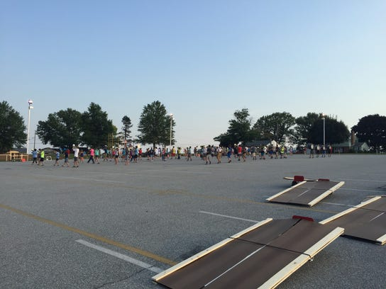 The Dallastown band practices its music and formations in the student parking lot on Monday, Aug 17.