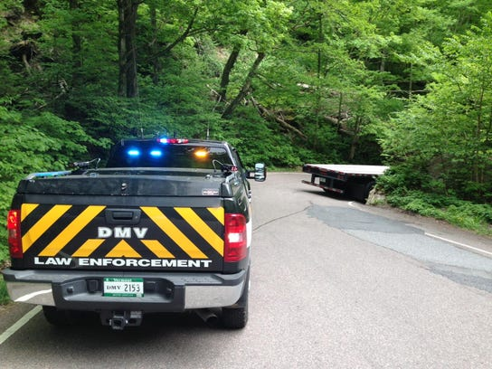 Vermont DMV enforcement vehicle at a scene in Smugglers