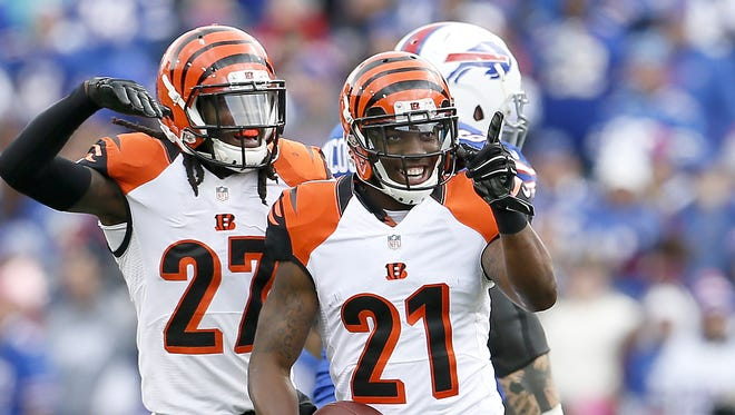 Bengals cornerback Darqueze Dennard (21) celebrates his first career interception last year in Buffalo.