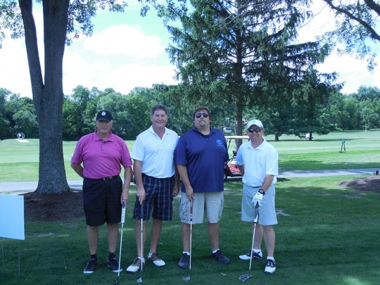 Team Rum Runners took first place in the CareFirst Charity Golf held Aug. 18 at the Elmira Country Club. Pictured, from left, are Bob Card, Ed Kauffman, Steve Paciorek and Greg Golder.