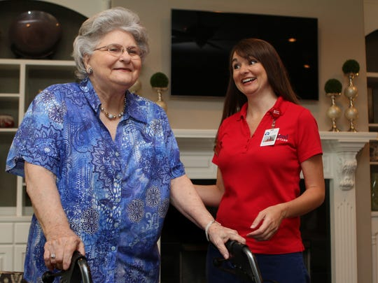 United Home Care nurse Autumn Fulmer works with Elizabeth Brewster during a home visit on Friday.