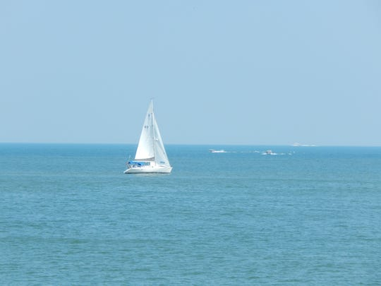 A sailboat makes its way toward Mouse Island on a recent afternoon.