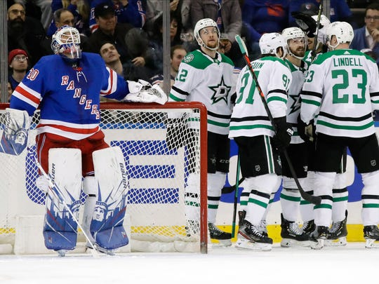New York Rangers goaltender Henrik Lundqvist (30) reacts as the Dallas Stars celebrate a goal by Blake Comeau during the second period of an NHL hockey game Monday, Feb. 3, 2020, in New York. (AP Photo/Frank Franklin II)