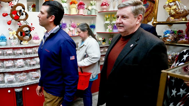 Republican Rick Saccone, right, and Donald Trump Jr., tour Sarris Candies during a campaign stop, Monday, March 12, 2018, in Canonsburg, Pa.