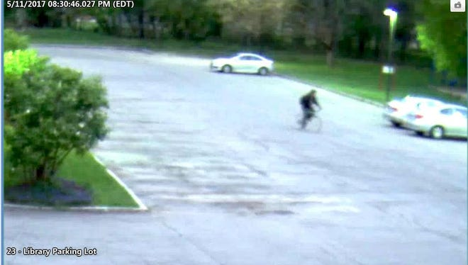 Brighton Police have provided this blurry image of the alleged suspect in a theft on Thursday at the town library parking lot.