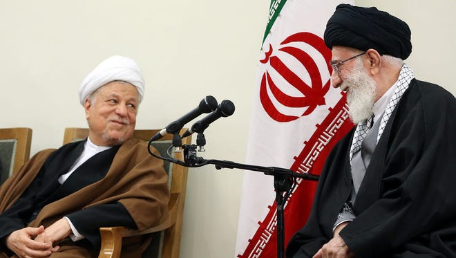 A handout picture released on March 12, 2015, by the official website of the Centre for Preserving and Publishing the Works of Iran's supreme leader Ayatollah Ali Khamenei, shows him him, right, speaking with former president and head of Expediency Council, Akbar Hashemi Rafsanjani, during a meeting with members of Assembly of Experts in Tehran.