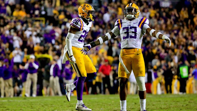 Oct 22, 2016; Baton Rouge, LA, USA; LSU Tigers safety Jamal Adams (33) and defensive back Andraez Williams (29) celebrate after a defensive stop against the Mississippi Rebels during the second half of a game at Tiger Stadium. LSU defeated Mississippi 38-21. Mandatory Credit: Derick E. Hingle-USA TODAY Sports