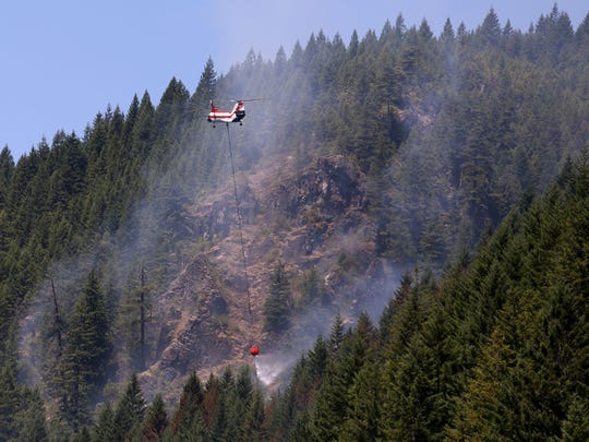 Four helicopters and 100 firefighters battled the 70-acre
