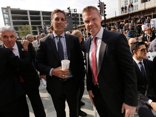 Former Red Wings Chris Chelios, left and Kris Draper chat before the ribbon-cutting ceremony to celebrate the opening of Little Caesars Arena in 2017.