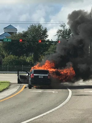 A motorist escaped safely after a car caught fire off Interstate 95 in Vero Beach, Fla., on Friday, Sept. 8, 2017. The man was on his way home to put up his hurricane shutters.