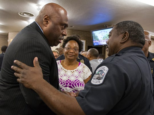 Derrick Diggs is congratulated by FMPD Captain Melvin Perry Thursday afternoon after a council meeting confirming Diggs' nomination as the next police chief.