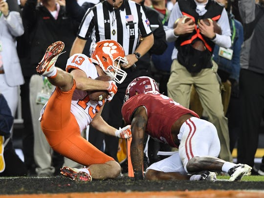 Clemson wide receiver Hunter Renfrow (13)  catches the winning touchdown past Alabama defensive back Tony Brown (2) late in the 4th quarter of the National Championship at Raymond James Stadium in Tampa on Monday, January 9, 2017.