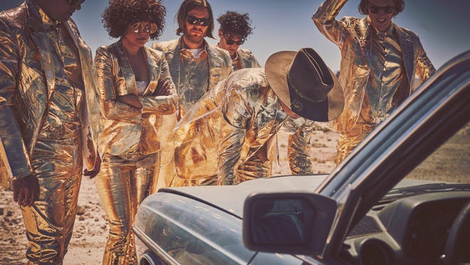Members of Canadian alternative rock band Arcade Fire, which returns Friday with new album 'Everything Now.'