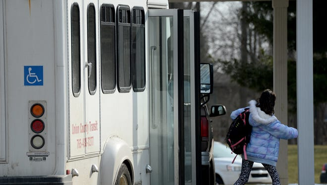 A student exits a Union County Transit bus Thursday, Feb. 18, 2016, in Liberty.