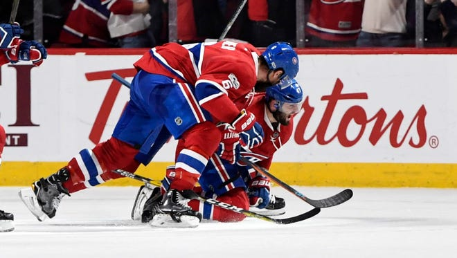 Montreal Canadiens forward Alexander Radulov (47) reacts with teammate Shea Weber (6) after scoring the winning goal during the overtime period of Game 2.